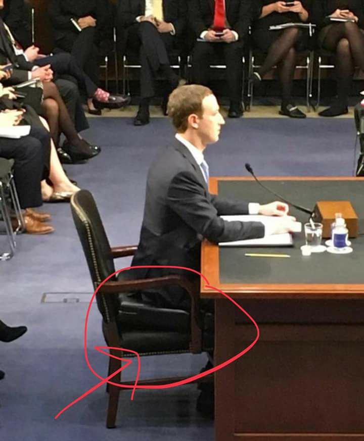 mark zuckerberg sitting on briefcase senate